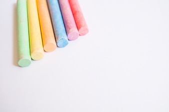 Colorful chalks on white