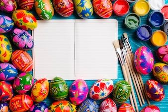 Colorful easter composition with blank notebook