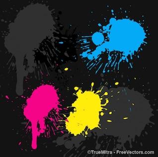 Colorful paints spots on black