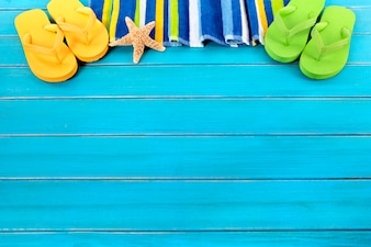 Coloured flip flops and summer towel