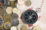 Compass with variety of coins