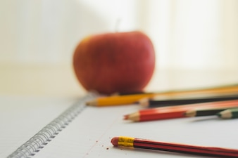 Composition of notepad and pencils