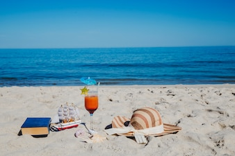 Composition of objects on beach for relaxing