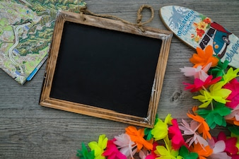 Composition with blackboard and summer elements