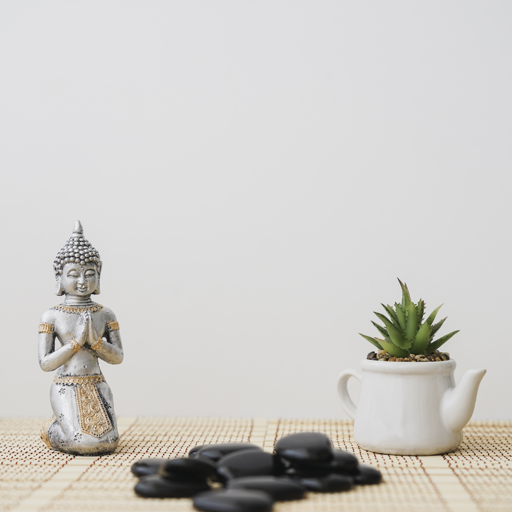 Composition with buddha figure and pot