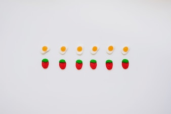 Composition with candy eggs and strawberries