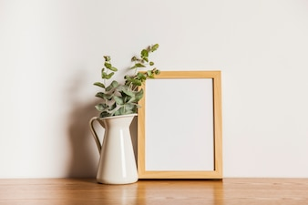 Composition with frame and flower pot