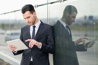 Concentrated analyst reviewing a document on your tablet