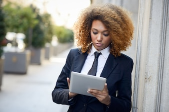 Concentrated employee with tablet