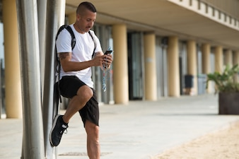 Concentrated man using phone while walking