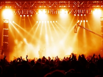 Concert scene with orange lights