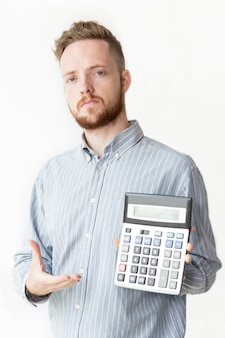 Confident banker showing interest on calculator