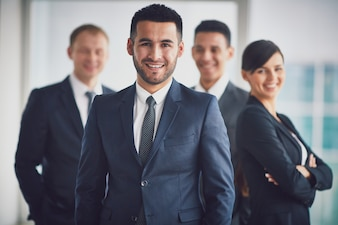 Confident business team with the leader