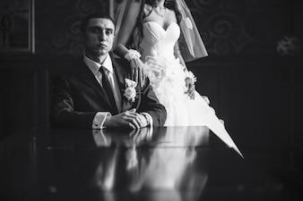 Confident groom with unrecognizable bride