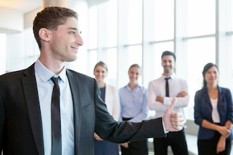 Confident handsome employer showing thumb-up