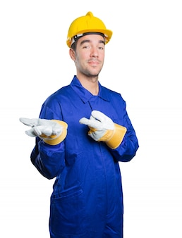 Confident workman with show gesture on white background