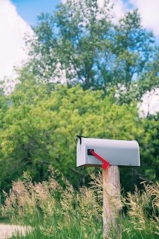Container flag gravel postal mailbox