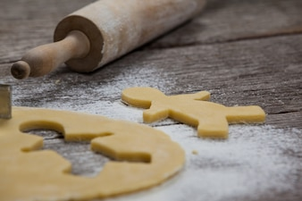 Cookie dough with a rolling pin and flour