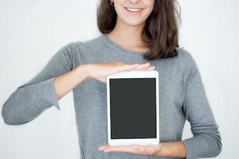 Cool girl holding digital tablet