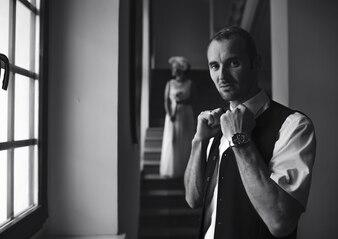 Cool stylish groom looking at camera