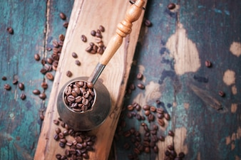 Copper utensil with coffee beans