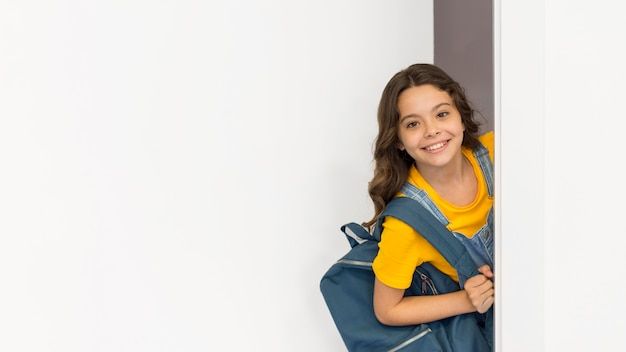 Copy-space girl with backpack