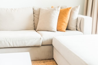 Corner of the couch with cushions