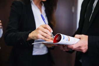 Corporate business people holding brochure