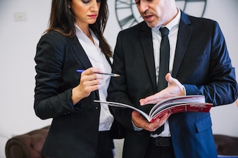 Corporate business people with brochure