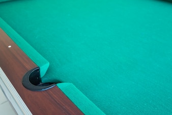 Corrner of table snooker hole .
