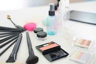 Cosmetic set on light dressing table.