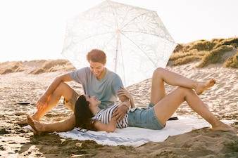 Couple chilling on beach