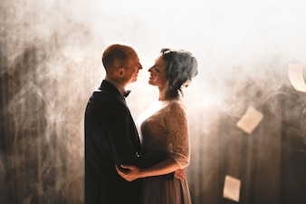 Couple dancing with white smoke background