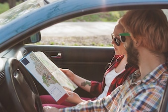 Couple driving and looking at map