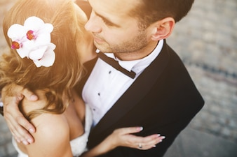 Couple embracing after getting married