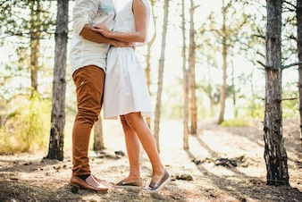 Couple embracing in a forest