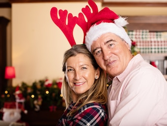 Couple embracing with christmas hats
