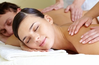 Couple getting back massages