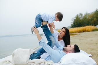Couple having fun with son