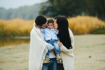 Couple holding and kissing son