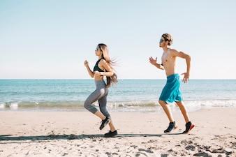 Couple jogging at the shoreline