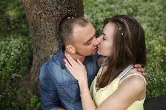 Couple kissing at tree