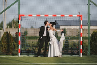 Couple kissing in a goal
