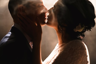 Couple kissing with white smoke background