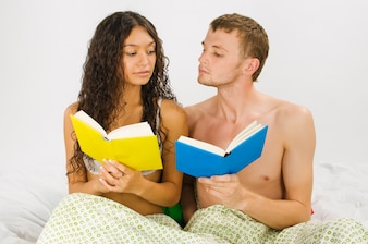 Couple leisure at the bedroom