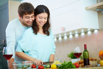 Couple preparing a salad for dinner