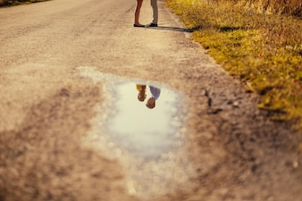 Couple reflected in a puddle