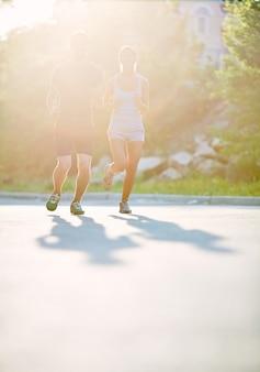 Couple running at dawn