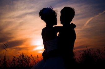 Couple silhouettes at the sunset