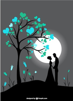 Couple silhouettes in moon light